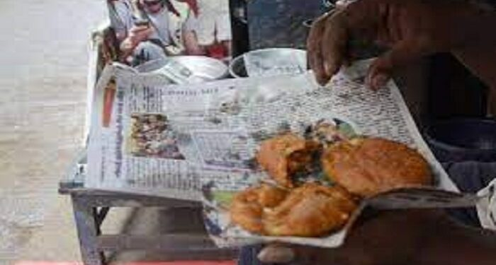 food wrapped in newspaper